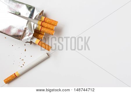 Cigarette on a white background with copy space