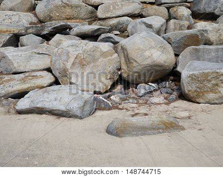 Big stones on the beach placed to protect the dunes from the ravages of the sea waves