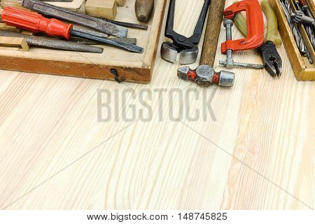 Old Tool Set Of Pliers, Clamp, Hammer, Screwdrivers And Other On Wooden Planks