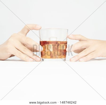 Hand Holding Glass Of Whiskey Isolated On White Background