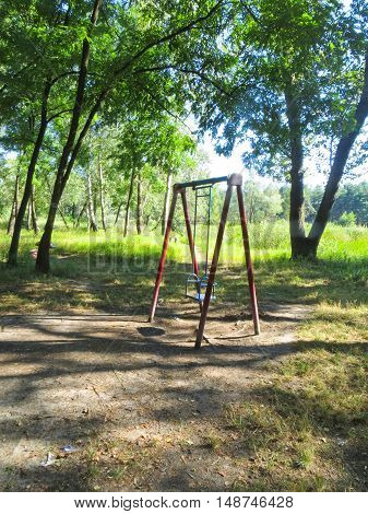 Empty children's playground in the birch forest