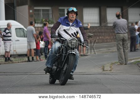 BELGRADE, SERBIA - SEPTEMBER 10, 2016: Oldtimer BMW motorcycle at the commercial race of old cars in memory of formula 1 race held on the same place in 1939 two days after the beginning of Second World War when the famous Italian driver Tazio Nuvolari won
