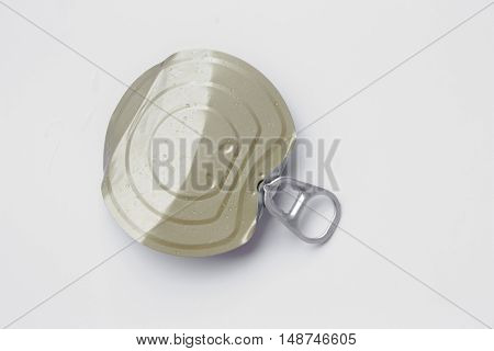 isolated lid of tin can on grey background