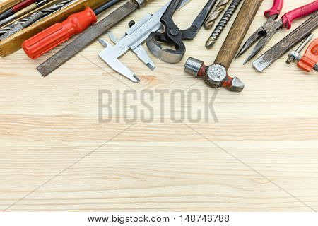 Various Old Hand Tools Including Hammer, Caliper, Screwdrivers And Other On Wooden Background