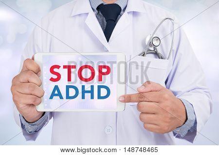 STOP ADHD Doctor holding digital tablet doctor work hard