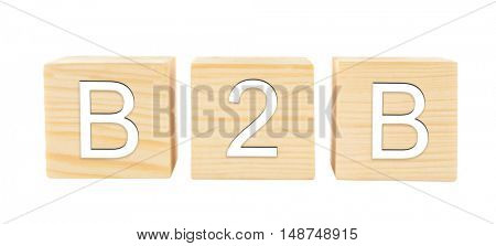 Wooden cubes in a row isolated on white