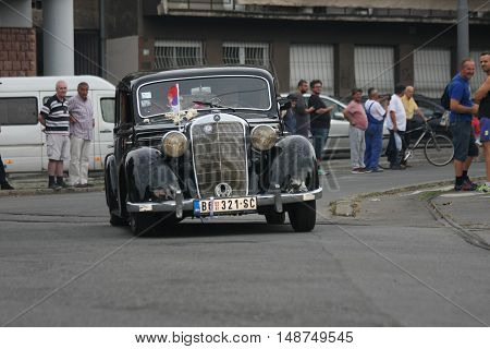 BELGRADE,SERBIA - SEPTEMBER 10, 2016: Oldtimer Mercedes-Benz at the commercial race of old cars in memory of formula 1 race held on the same place in 1939 two days after the beginning of Second World War when the famous Italian driver Tazio Nuvolari won