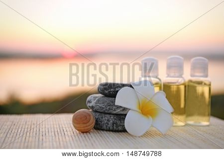 Spa composition on sunset background