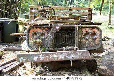 old car antique rusted left in farm