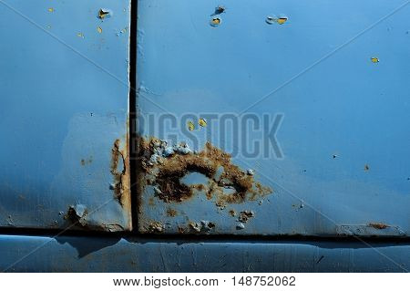 rust on the car rusted on through