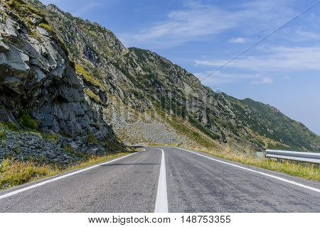 Winding mountain road with dangerous curves in Carpathian mountains. Transfagarasan road in Romania.