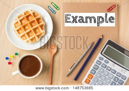 Example, text message on paper book and office supplies, pen, coffee on wood desk , copy space / business concept / view from above, top view