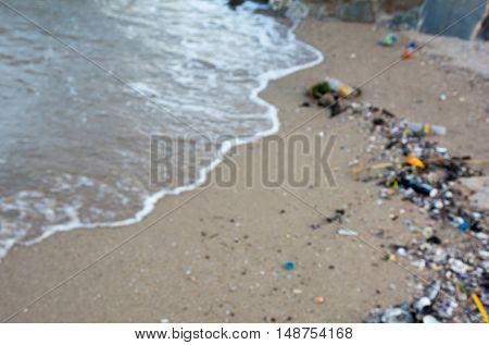 Pollution on the beach with blurred background