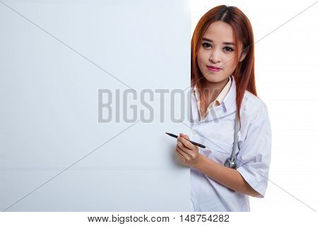 Young Asian Female Doctor Peeking From Behind Blank Sign Point With A Pen.