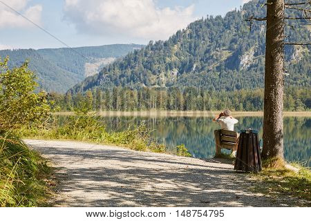Man On A Bench At Lake Offensee