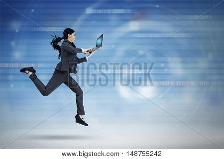 Concept of fast internet connection with young businesswoman running inside virtual world while using laptop
