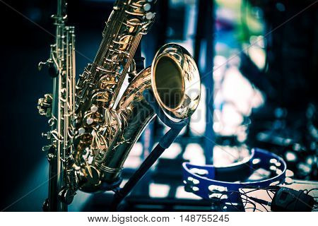 Saxophone Instrument Closeup. Golden Shiny Saxophone on the Stage.