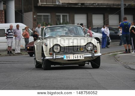 BELGRADE,SERBIA - SEPTEMBER 10, 2016: Old Triumph at the commercial race of old cars in memory of formula 1 race held on the same place in 1939 two days after the beginning of Second World War when the famous Italian driver Tazio Nuvolari won