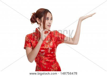 Asian Girl In Chinese Cheongsam Dress  Show Ok With  Blank Space On Her Hand.