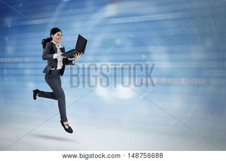Concept of fast internet connection with female entrepreneur running in cyberspace while using laptop computer