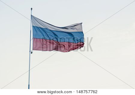 Russian tricoloured flag waving in the wind.