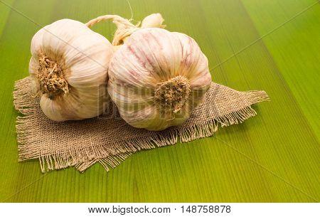 Fresh Garlic On Green Board Close Up