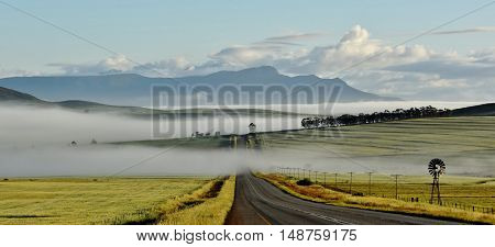Landscape with quiet Country Road and morning fog...