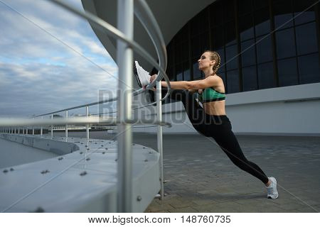 Happy Girl Stretch Outdoor At Modern Urban Area During Sunset