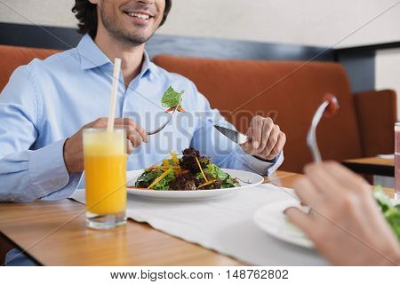 Enjoying good food and company. Cropped shot of smiling couple preparing to eat lunch together in restaurant
