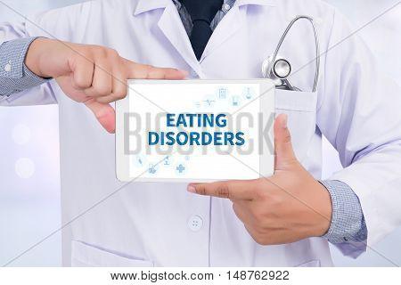 EATING DISORDERS Doctor holding digital tablet doctor work hard