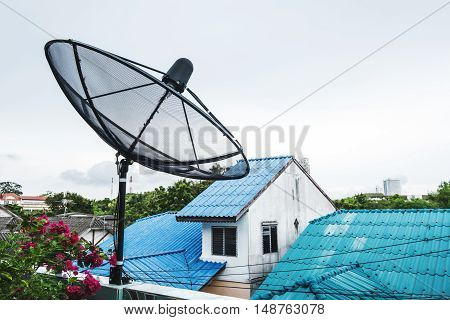 Home Satellite Dish on a roof top in rural area