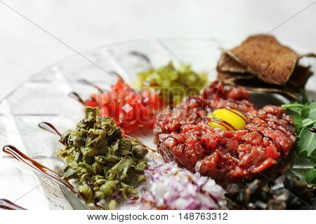 Plate with diced meat and different snacks