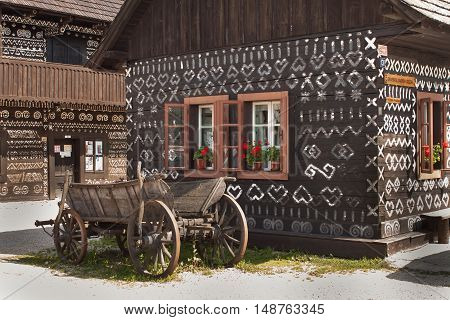 CICMANY, SLOVAK REPUBLIC, AUGUST 23, 2016: Traditional folk architecture. The old wooden house painted ornament. The village Cicmany with the painted wooden houses is on the list of UNESCO.