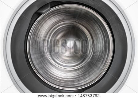 Spin motion of internal view of a washing machine drum during wash