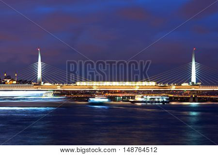 Ataturk bridge and Golden Horn at twilight in Istanbul Turkey