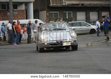 BELGRADE,SERBIA - SEPTEMBER 10, 2016: Guests from Italy at the commercial race of old cars in memory of formula 1 race held on the same place in 1939 two days after the beginning of Second World War when the famous Italian driver Tazio Nuvolari won