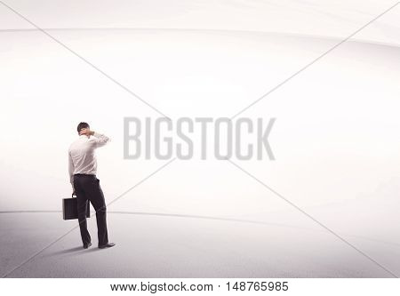 Young sales business male in elegant suit standing with his back in empty white space background with lines concept