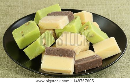 selection of fresh creamy barfi plain chocolate and pistachio