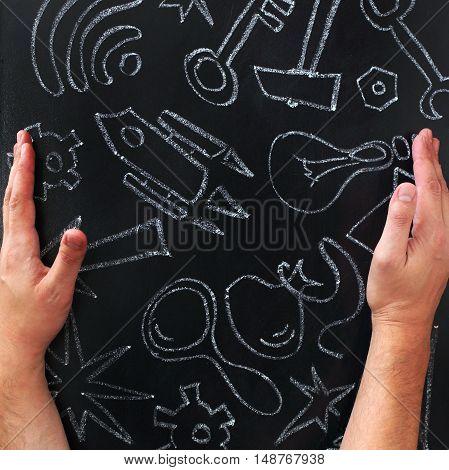symbols ideas drawn with chalk on blackboard / creative recipe for innovation