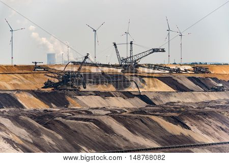 GARZWEILER, GERMANY - SEPTEMBER 16, 2016: Huge machines refill the opencast mine