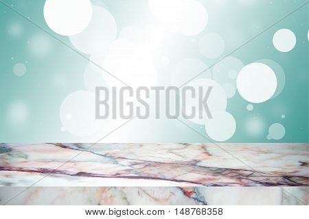 white marble stone countertop or table on green-blue blurred abstract background / empty marble / for display or montage your products