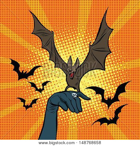 Evil bat sitting on the hand, pop art retro vector illustration. Halloween and witchcraft witches