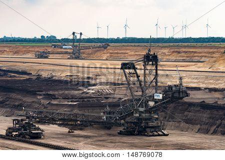 GARZWEILER, GERMANY - SEPTEMBER 16, 2016 :Huge Excavators mines in an opencast mining field