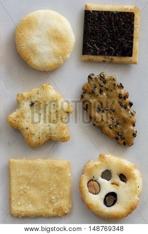Assorted Japanese crisp savoury biscuits as background.