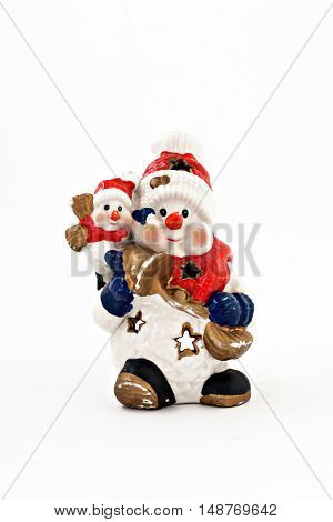 a ceramic statuette of two snowmen isolated.