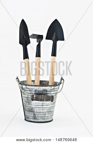 garden shovel rake and a metal bucket isolated.