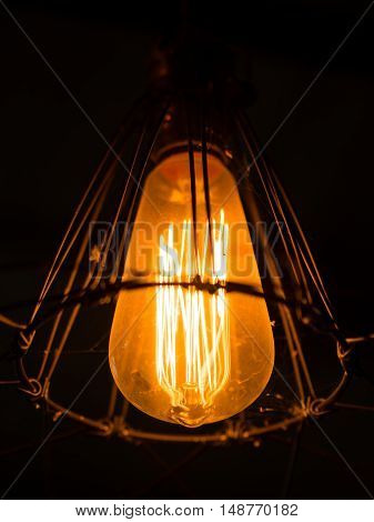 light bulb and lamp in vintage style. Warm tone light bulb lamp. Lamps in coffee shop.