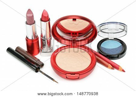 Set of decorative cosmetics: powder eye shadow lipstick and contour pencils isolated on white background.