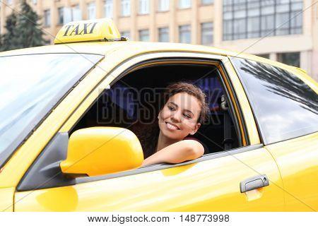 Female taxi driver in car