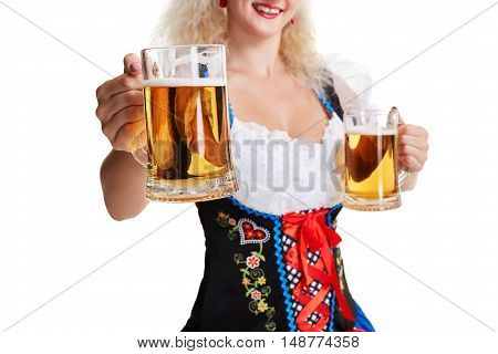 Beautiful young blond girl drinks out of oktoberfest beer . Isolated on white background. she holds a glass with a drink and smiling. Close up